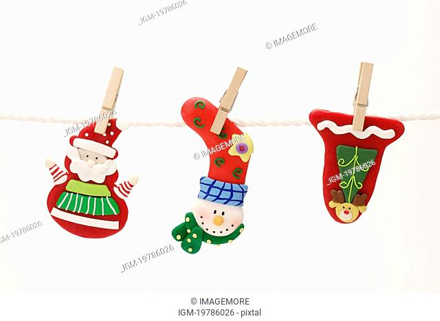 Christmas objects hanging on line