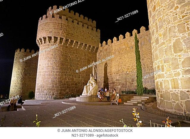 Walls and battlements at night. Statue of Santa Teresa. Fortified city of Avila, Castilla-Leon, Spain, Europe