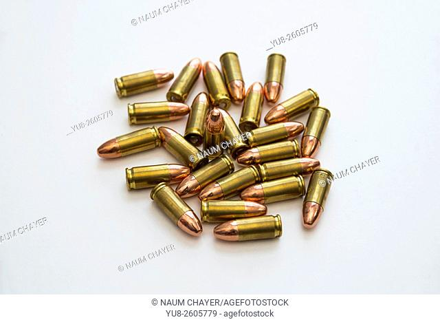 Several 9mm caliber bullets for the pistol on the table