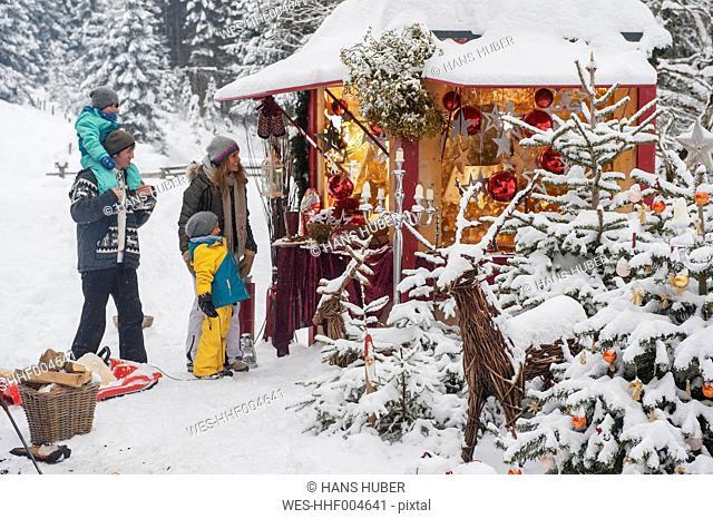 Austria, Altenmarkt, family at Christmas market