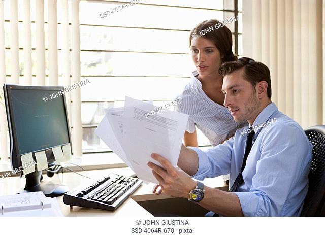 Employees collaborating at desk