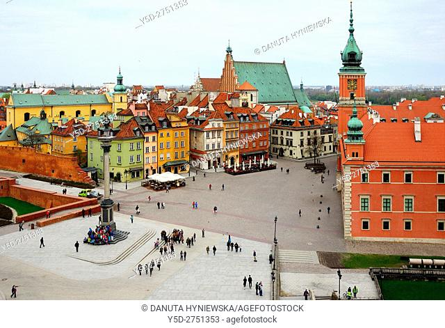 Royal Castle - former official residence of Polish monarchs, Castle square, Old Town of Warsaw, in background on left yellow walls of St