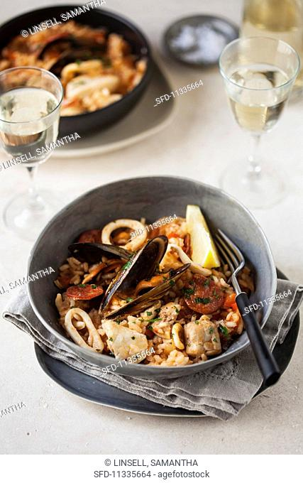Paella with mussels and squid