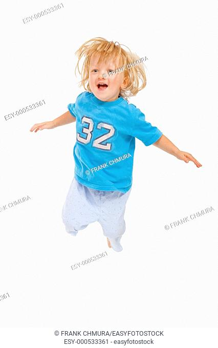 energetic 3 years old boy jumping in the air