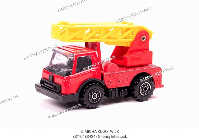 Toy firetruck with ladder folded, on white background