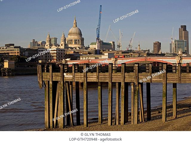 England, London, Blackfriars Bridge, A jetty on the South Bank of the River Thames with Blackfriars road bridge and St. Paul's Cathedral in the background