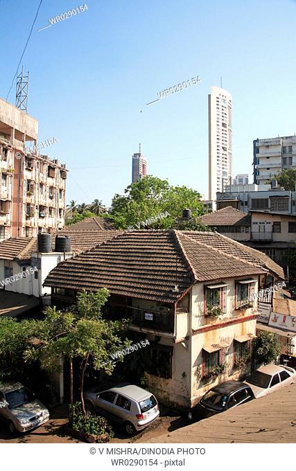Old chawl mud roof and skyscraper , Mahalakshmi , Maharashtra , India