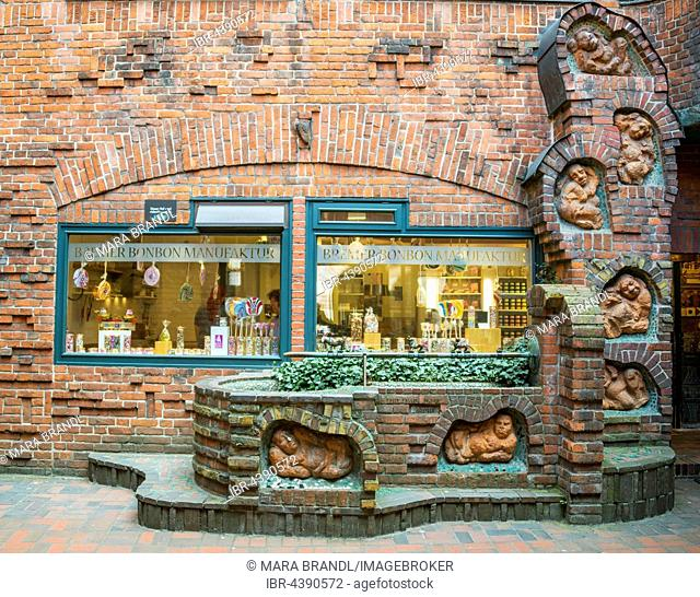 Brick house with Bremer Sweet manufacture, before Seven Lazy Brothers fountain of Thomas Hoetger, Böttcherstraße, Handwerkerhof, Altstadt, Bremen, Germany