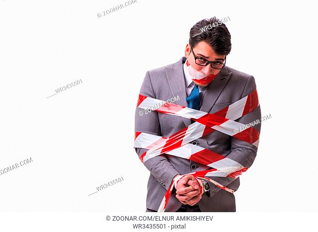 Businessman tied by tape isolated on white