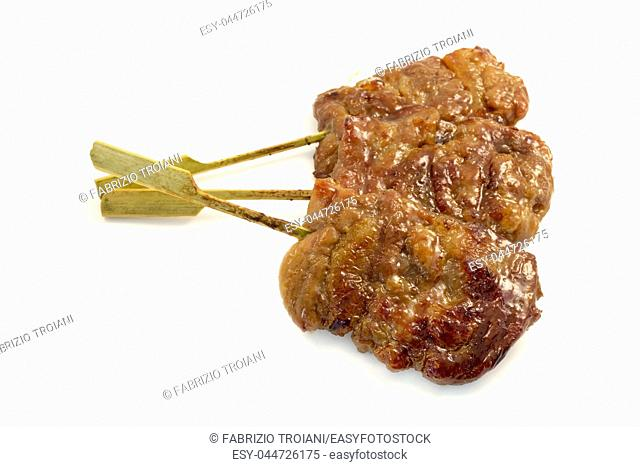 Moo Ping (Thai-style grilled pork on a skewer) on a white background