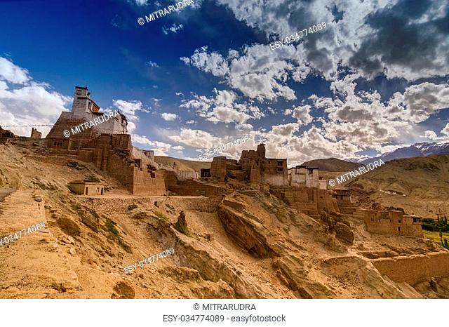 Ruins and Basgo Monastery surrounded with stones and rocks , Leh, Ladakh with blue sky with clouds in the background, India