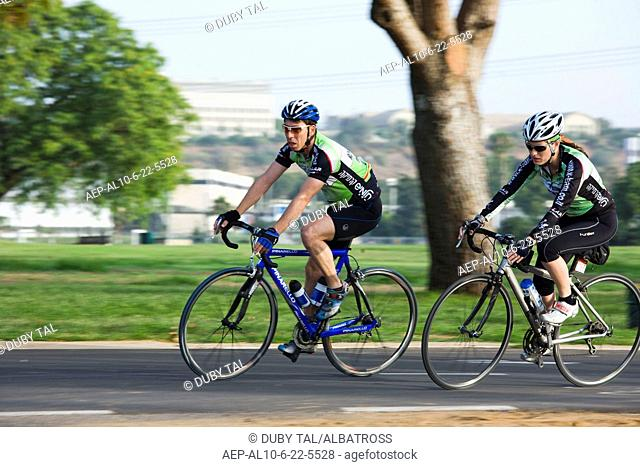 Photograph of a bicycle riders in the Yarkon Park - the green lungs of the city of Tel Aviv