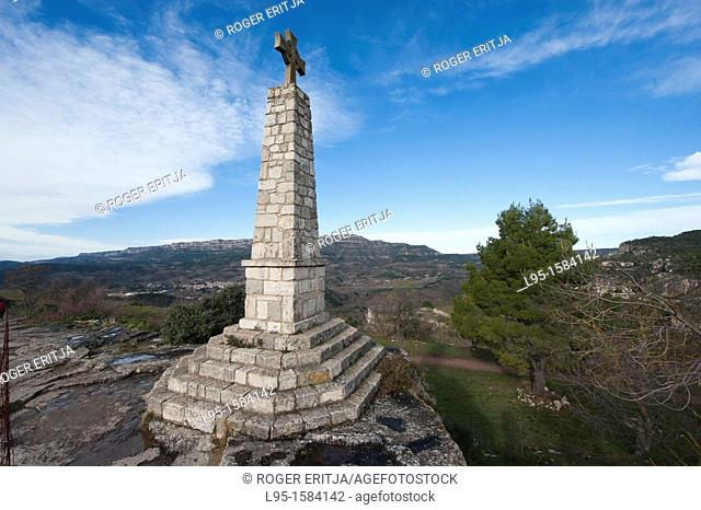 Stone cross at the limits of the small rock-perched village of Siurana, Tarragona province, Catalonia, Spain