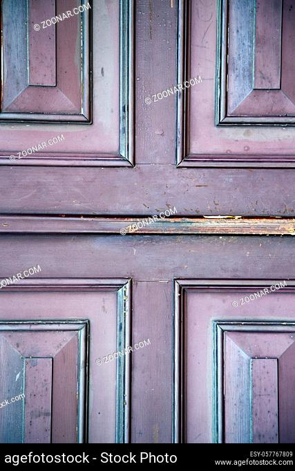 abstract samarate  rusty brass brown knocker in a door curch closed wood lombardy italy varese