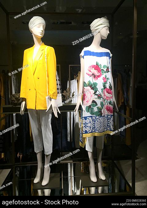 Two mannequins model the latest summer styles in a store window, Siracusa, Sicily