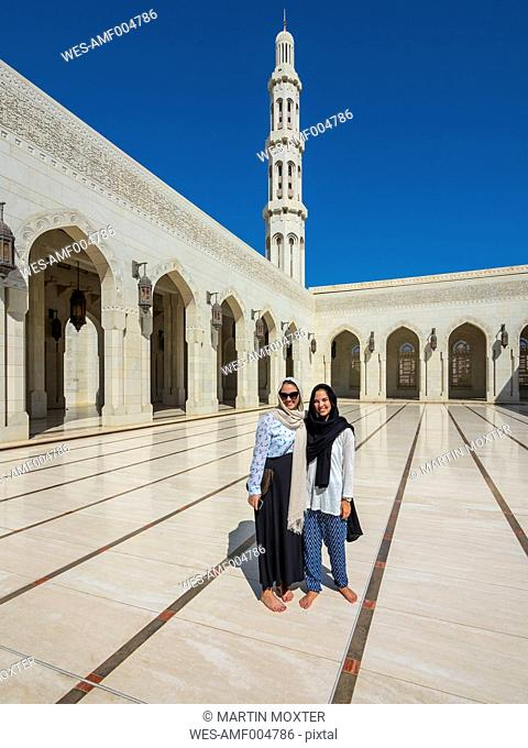 Oman, Muscat, Sultan Qaboos Grand Mosque, two female tourists with headscarf