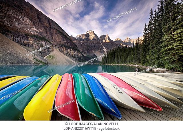 Canoes at Moraine Lake backed by the Wenkchemna Peaks in the valley of the ten peaks
