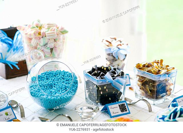 Table with glass jars filled with candy