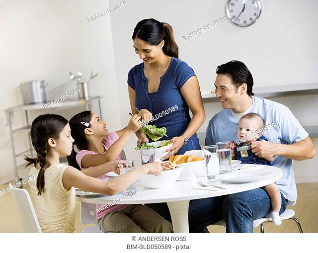 Multi-ethnic family at dinner table