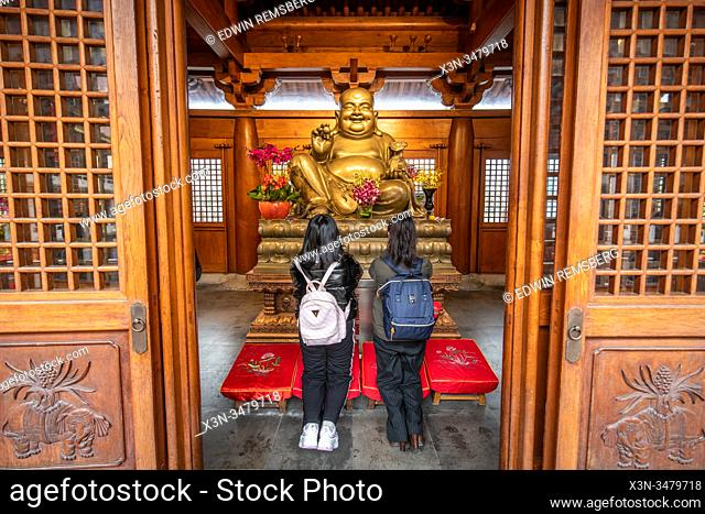 People praying at an altar in the Jing'an Temple , Shanghai, China