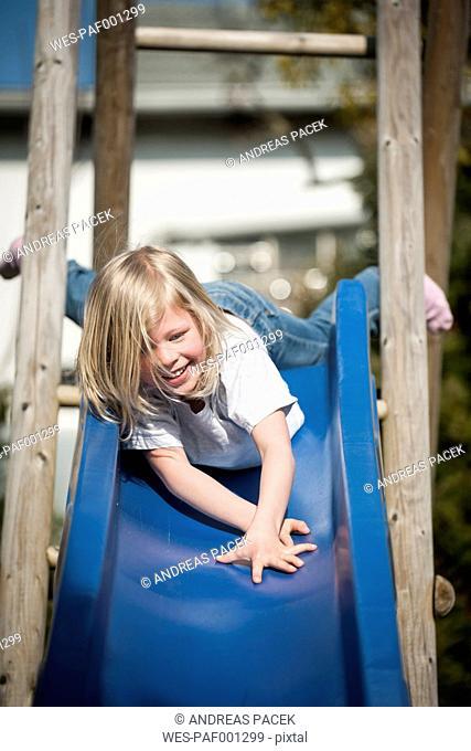 Happy girl on a slide