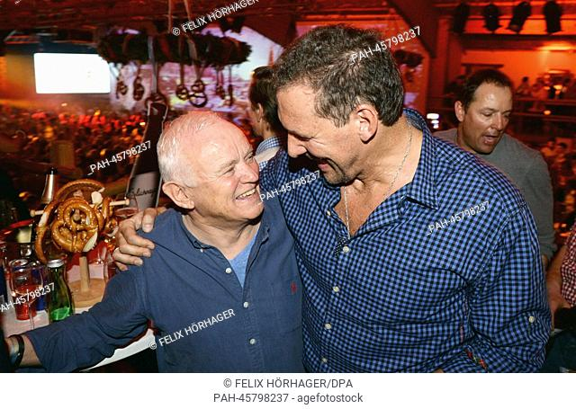 Designer and former Hugo Boss chairman Werner Baldessarini (L) and actor Ralf Moeller (R) pose at the Bavarian veal sausage party in the Stanglwirt bar near...