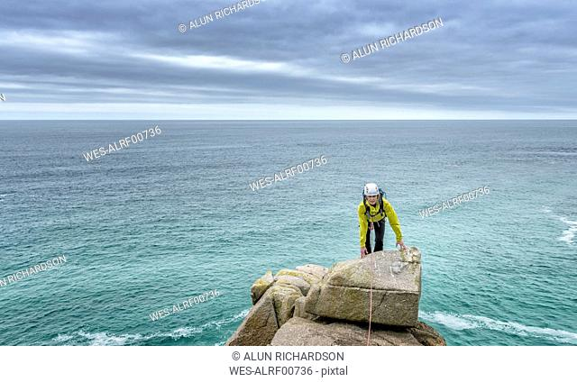UK, Cornwall, woman on peak of Commando Ridge climbing route