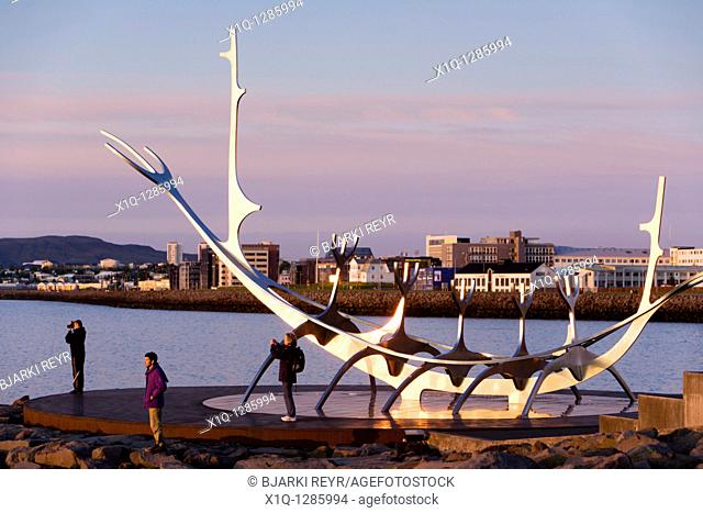People enjoying the midnight sun  Solfar sculpture, Reykjavik Iceland