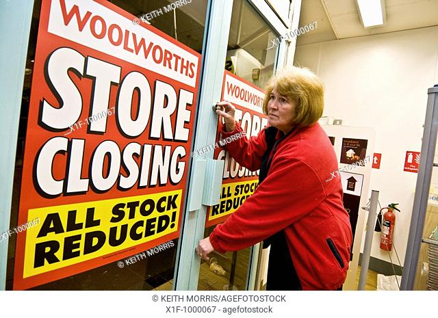 DELYTH DAVIES, closing the doors of WOOLWORTHS Aberystwyth for the vewry last time as the store closed for business on Saturday 27th September 2008  She had...
