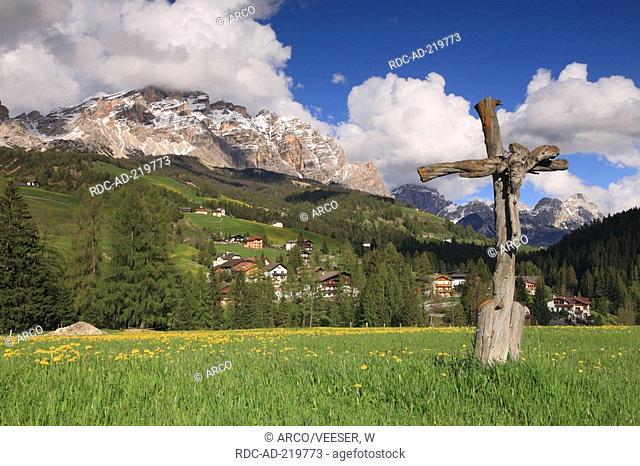 Wooden cross on meadow, Gader valley, Alta Badia, Alto Adige, South Tyrol, Italy
