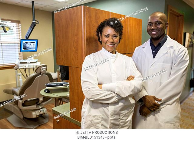 Dentists smiling together in office