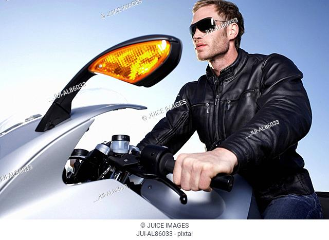 Low angle view of man riding motorcycle