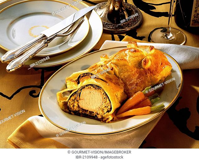 Vienna-style pork fillet with a spicy mushroom farce and a crispy puff pastry wrap, Austria