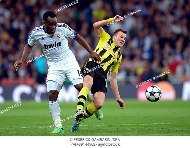 Dortmund's Kevin Grosskreutz and Real's MichaelEssien (L) vie for the ball during the UEFA Champions League semi final second leg soccer match between Borussia...