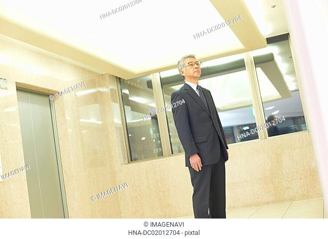 Senior businessman waiting for lift