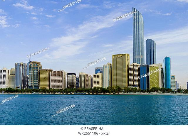 Skyscrapers in the Al Markaziyah district and Corniche viewed from the Gulf, Abu Dhabi, United Arab Emirates, Middle East