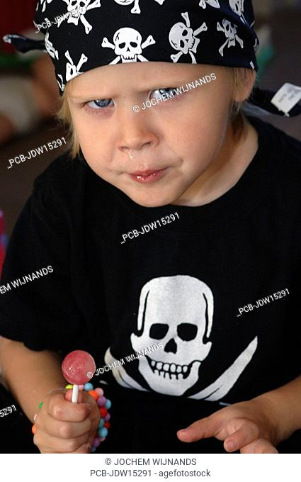 Girl with pirate symbols of skull and crossed swords on her shirt