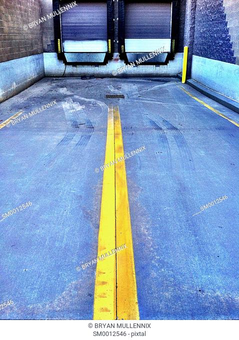 An empty loading dock waiting for delivery by truck