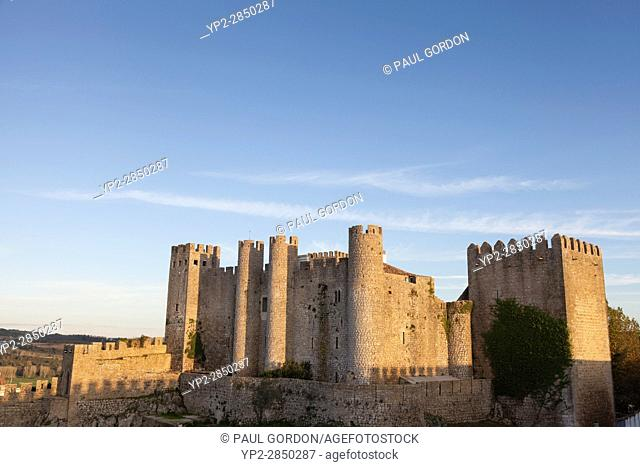 Óbidos, Portugal: The medieval castle of Óbidos perched over the walled citadel
