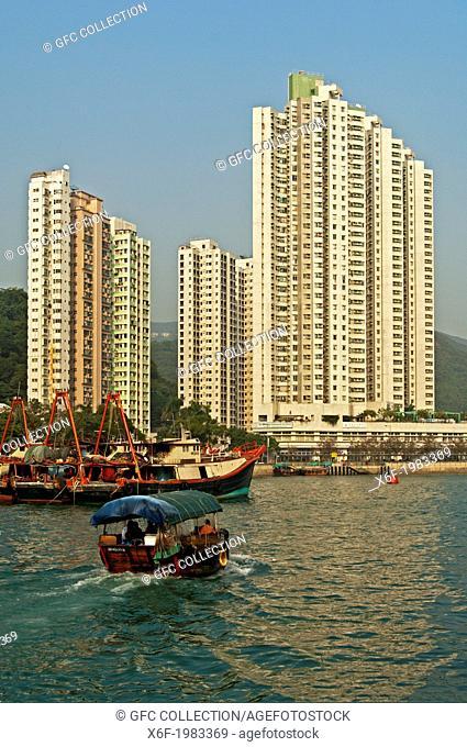 Sampan boat in the Aberdeen Harbour, skyscrapers overlooking the Aberdeen Channel, Aberdeen, Hong Kong
