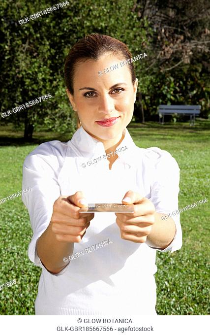 Portrait of a businesswoman showing a credit card