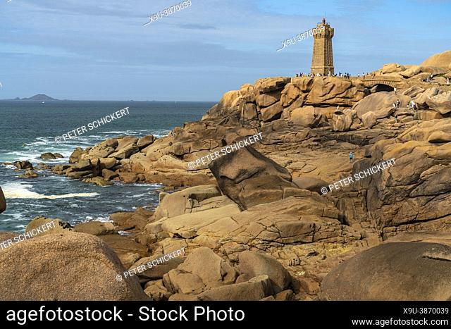 Rock formations of the Côte de granite rose or Pink Granite Coast and the lighthouse Phare de Ploumanac'h near Ploumanac'h, Perros-Guirec, Brittany, France