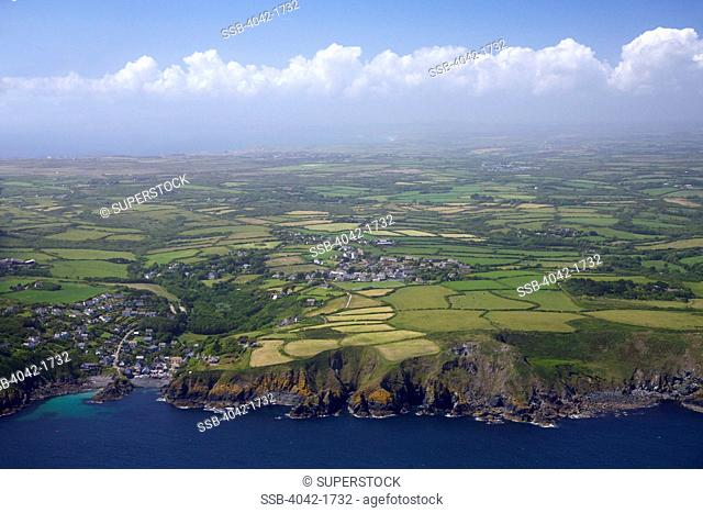 United Kingdom, Cornwall, Lizard Peninsula, Aerial view of Cadgwith in summer sun