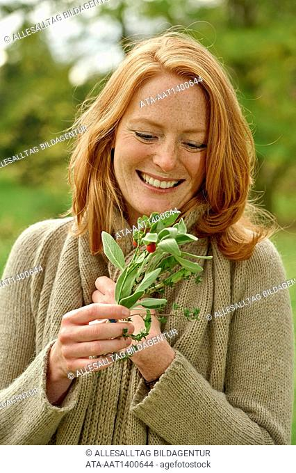 Woman with a bunch of medicinal herb