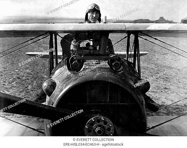 First Lieut. Eddie Rickenbacker, American World War I ace, standing up in his Spad plane. Near Rembercourt, France. Oct. 18, 1918