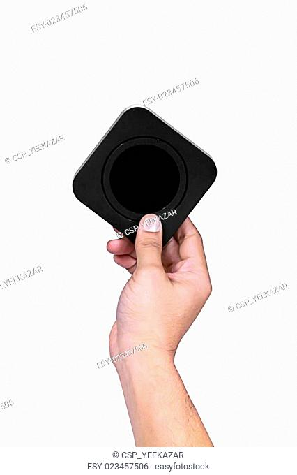 Hand holding square black box and black circle inside box