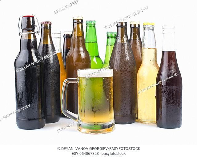 Bottles of beer and beer mug. White isolated studio shot