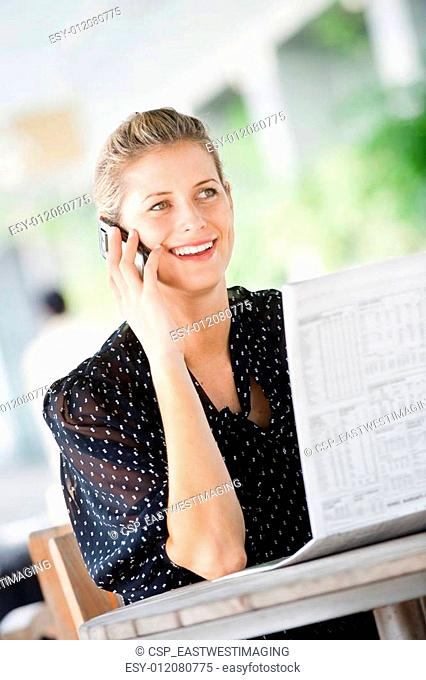 Woman with Phone and Newspapers