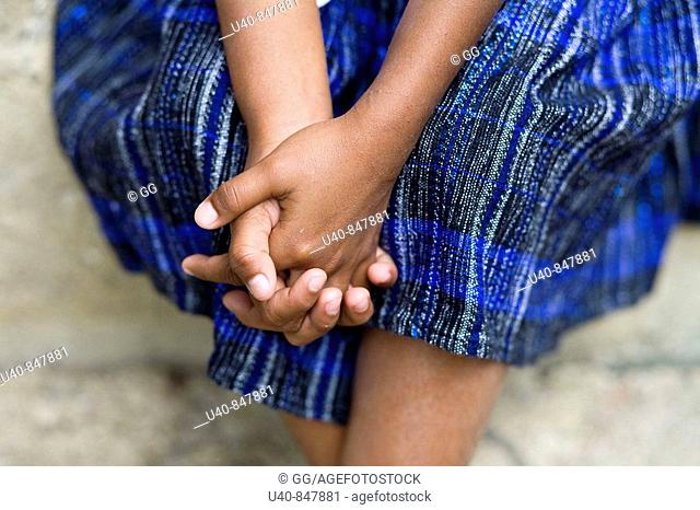 Guatemala, Rio Dulce, girl with clasped hands