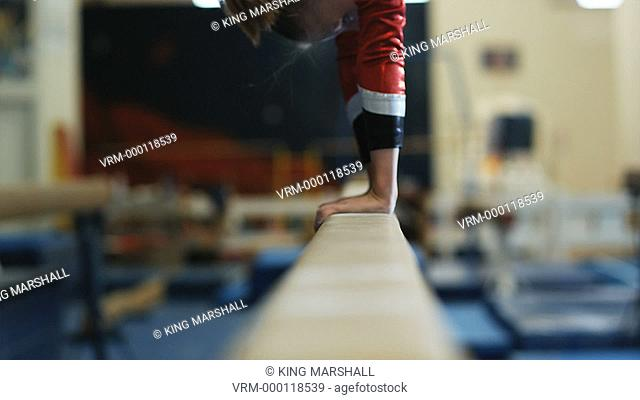 CU TU Girl 12-13 performing gymnastics on the balance beam / Lindon, Utah, USA